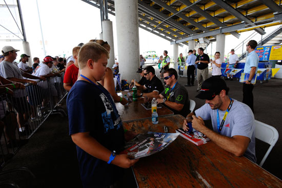 NASCAR Camping World Truck Series drivers signed autographs for fans before the start of the Coca-Cola 200 presented by Hy-Vee at Iowa Speedway on July 16 in Newton, Ia. (Credit: Jason Smith/Getty Images)