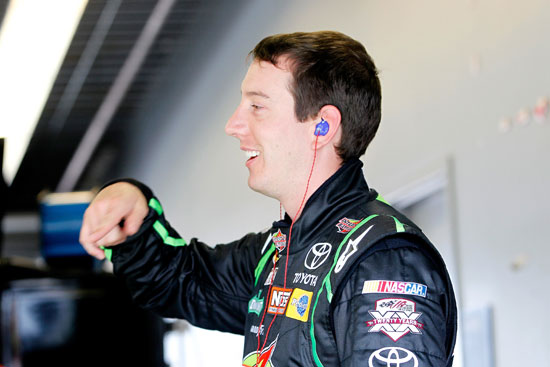 Kyle Busch laughs in the NASCAR Nationwide Series garage as he prepared to turn practice laps Thursday at Daytona International Speedway. (Credit: Geoff Burke, Getty Images for NASCAR)