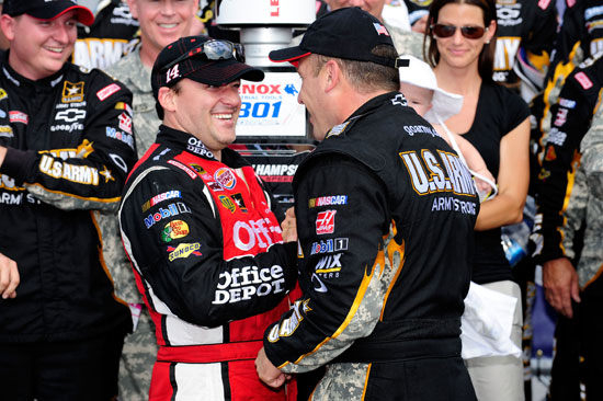 Ryan Newman is congratulated in Victory Lane by owner and teammate Tony Stewart after the duo finished first and second in the NASCAR Sprint Cup Series Lenox Industrial Tools 301 on Sunday at New Hampshire Motor Speedway in Loudon, N.H. (Credit: Jared C. Tilton/Getty Images)