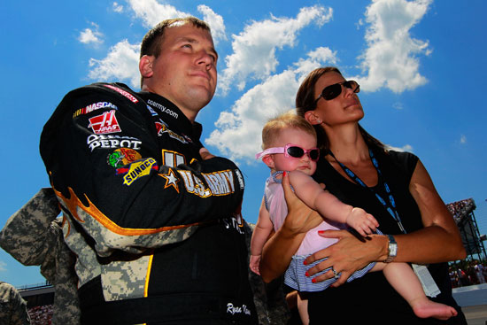 Coors Light Pole Award winner Ryan Newman, daughter Brooklyn Sage and wife Krissie stand together before the NASCAR Sprint Cup Series 19th Annual Lenox Industrial Tools 301 on Sunday at New Hampshire Motor Speedway in Loudon, N.H. (Credit: Geoff Burke/Getty Images for NASCAR)