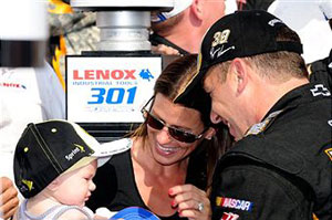 Ryan Newman (R), driver of the #39 U.S. Army Chevrolet, is congratulated by his wife Krissie and their daughter Brooklyn Sage in Victory Lane after Newman won the NASCAR Sprint Cup Series LENOX Industrial Tools 301 at New Hampshire Motor Speedway on July 17, 2011 in Loudon, New Hampshire. (Photo by Jared C. Tilton/Getty Images)