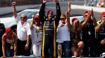 Paul Menard, driver of the No. 27 NIBCO/Menards Chevrolet, celebrates on the bricks after winning the NASCAR Sprint Cup Series Brickyard 400 at Indianapolis Motor Speedway on July 31 in Indianapolis, Ind. (Credit: Chris Graythen/Getty Images)