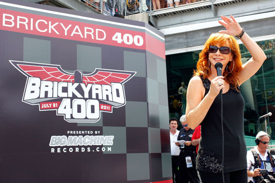 Singer Reba McEntire performs on stage prior to the start of the NASCAR Sprint Cup Series Brickyard 400 at Indianapolis Motor Speedway on July 31 in Indianapolis, Ind. (Credit: Geoff Burke/Getty Images for NASCAR)