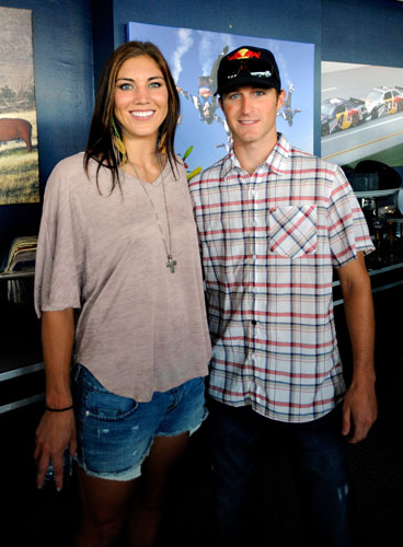 Kasey Kahne (right), driver of the No. 4 Red Bull Toyota, poses with American soccer goalkeeper Hope Solo (left) prior to the NASCAR Sprint Cup Series Brickyard 400 at Indianapolis Motor Speedway on July 31 in Indianapolis, Ind. (Credit: Jason Smith/Getty Images for NASCAR)
