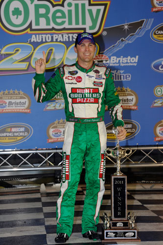 Kevin Harvick celebrates completing the hat trick of national series wins on Wednesday in Bristol Motor Speedway's Victory Lane, adding a NASCAR Camping World Truck Series trophy to his NASCAR Sprint Cup Series and NASCAR Nationwide Series wins. (Credit: John Harrelson/Getty Images for NASCAR)