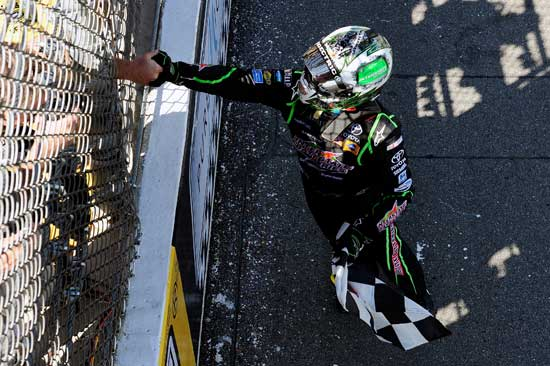 Kyle Busch, driver of the No. 18 Interstate Batteries Toyota, celebrates after winning the NASCAR Sprint Cup Series Pure Michigan 400 at Michigan International Speedway on Aug. 21 in Brooklyn, Mich. (Credit: Jared C. Tilton/Getty Images for NASCAR)