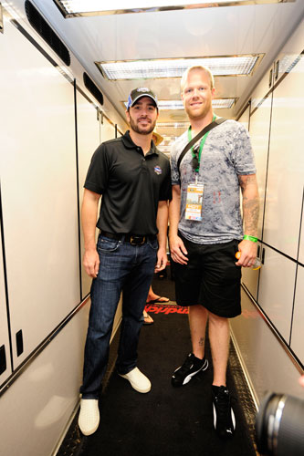 NASCAR Sprint Cup Series five time champion Jimmie Johnson poses with NHL Washington Capitals defenseman Josh Erskine in the No. 48 hauler during pre-race for the NASCAR Sprint Cup Series Good Sam RV Insurance 500 at Pocono Raceway on Aug. 7 in Long Pond, Pa. (Credit: Jared C. Tilton/Getty Images for NASCAR)