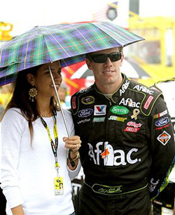 Carl Edwards (R), driver of the #99 Ortho Home Defense Max Ford, Ford, stands on the grid with his wife Kate (L) prior to the NASCAR Sprint Cup Series Heluva Good! Sour Cream Dips at the Glen at Watkins Glen International on August 14, 2011 in Watkins Glen, New York. (Photo by Jerry Markland/Getty Images for NASCAR)
