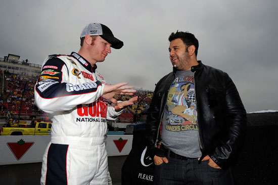 Adam Richman (right), host of Man v. Food, talks with Dale Earnhardt Jr.(left), driver of the No. 88 National Guard/Amp Energy Chevrolet, on the grid during pre race ceremonies prior to the NASCAR Sprint Cup Series Heluva Good! Sour Cream Dips at the Glen at Watkins Glen International on Aug. 14 in Watkins Glen, N.Y. (Credit: Jason Smith/Getty Images for NASCAR)