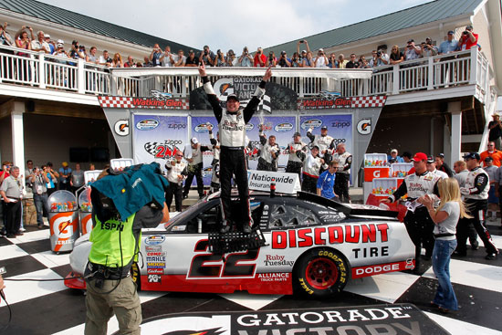 Kurt Busch, driver of the No. 22 Discount Tire/Ruby Tuesday Dodge, celebrates in Victory Lane after winning the NASCAR Nationwide Series Zippo 200 at Watkins Glen International on Aug. 13 in Watkins Glen, N.Y. (Credit: Geoff Burke/Getty Images for NASCAR)