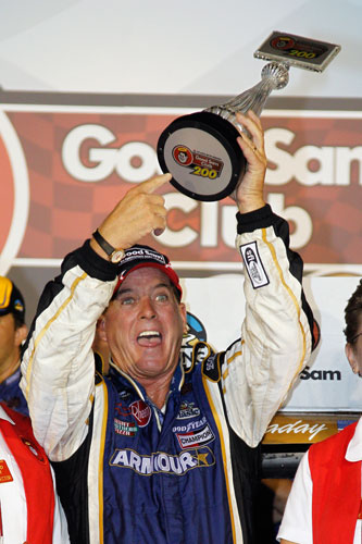 Ron Hornaday, driver of the No. 33 Armour/Ingles Chevrolet, celebrates after winning the NASCAR Camping World Truck Series Good Sam Club 200 at Atlanta Motor Speedway on Sept. 2 in Hampton, Ga. (Credit: Chris Graythen/Getty Images)