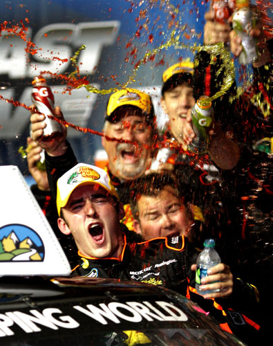 Austin Dillon, driver of the No. 3 Bass Pro Shops/Tracker Chevrolet, celebrates in Victory Lane after winning the NASCAR Camping World Truck Series Fast Five 225 at Chicagoland Speedway on Sept. 16 in Joliet, Ill. (Credit: Jerry Markland/Getty Images for NASCAR)