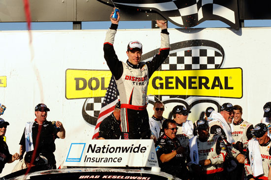 Brad Keselowski, driver of the No. 22 Discount Tire Dodge, celebrates in Victory Lane after winning the NASCAR Nationwide Series Dollar General 300 Powered by Coca-Cola at Chicagoland Speedway on Sept. 17 in Joliet, Ill. (Credit: Jason Smith/Getty Images for NASCAR)