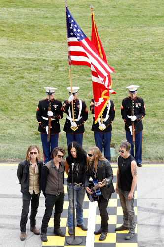 American rock band Red Jumpsuit Apparatus perform the National Anthem prior to the start of the NASCAR Sprint Cup Series GEICO 400 at Chicagoland Speedway on Sept. 19 in Joliet, Ill. (Credit: Todd Warshaw/Getty Images for NASCAR)