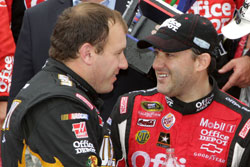 Ryan Newman (left), driver of the No. 39 U.S. Army Medicine Chevrolet, congratulates Tony Stewart (right) in Victory Lane after winning the NASCAR Sprint Cup Series GEICO 400 at Chicagoland Speedway. (Credit: Jerry Markland/Getty Images for NASCAR)
