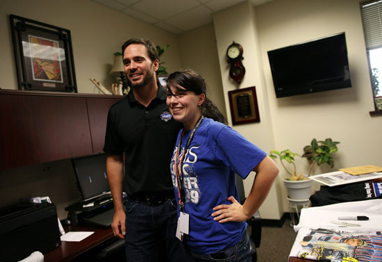 Sarah Rusinko (R) had the chance to meet five-time NASCAR Sprint Cup Series champion Jimmie Johnson after she asked him to homecoming during a Texas football-style pep rally at Byron Nelson High School on Wednesday in Trophy Club, Texas. (Credit: Tom Pennington/Getty Images for Texas Motor Speedway)
