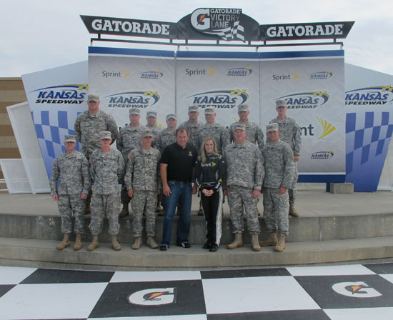 Ryan Newman and Kim Coon pose for a photo with the Ft. Riley soldiers at Kansas Speedway on Sept 14 in Kansas City, Kan. Newman is seeded eighth going into the Chase for the NASCAR Sprint Cup Series. (Credit: Kansas Speedway)