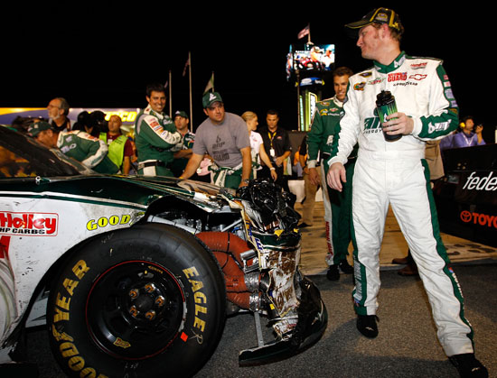 Dale Earnhardt Jr. jokes with his No. 88 crew about the state of his Chevrolet Impala after clinching the 10th spot in the Chase for the NASCAR Sprint Cup on Saturday at Richmond International Raceway. (Credit: Chris Graythen/Getty Images)
