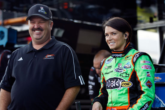 Danica Patrick, driver of the No. 7 GoDaddy.com/GetYour.net Chevrolet, stands with crew chief Tony Eury Jr. in the garage area during practice for the NASCAR Nationwide Series Virginia 529 College Savings 250 at Richmond International Raceway on Sept. 9 in Richmond, Va. (Credit: Chris Graythen/Getty Images)