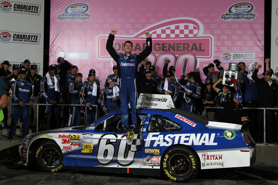 Carl Edwards, driver of the #60 Fastenal Ford, celebrates in Victory Lane after winning the NASCAR Nationwide Series Dollar General 300 Miles of Courage at Charlotte Motor Speedway on October 14, 2011 in Charlotte, North Carolina. (Credit: Jerry Markland/Getty Images for NASCAR)