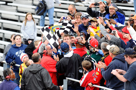 Carl Edwards celebrates with fans in the grandstand after winning the NASCAR Nationwide Series OneMain Financial 200 on Saturday at Dover International Speedway in Dover, Del. (Credit: Jason Smith/Getty Images for NASCAR)