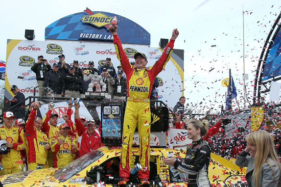 Kurt Busch celebrates in Sunoco Victory Lane on Sunday at Dover International Speedway in Dover, Del. after winning the third Chase for the NASCAR Sprint Cup race of the 2011 season. (Credit: Tom Whitmore/Getty Images for NASCAR)