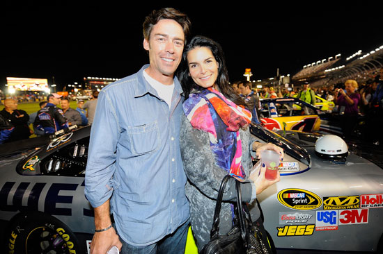Actress Angie Harmon (R) and former NFL player Jason Sehorn (L), friends of Jimmie Johnson, attend the NASCAR Sprint Cup Series Bank of America 500 at Charlotte Motor Speedway on October 15, 2011 in Charlotte, North Carolina. (Credit: Jason Smith/Getty Images for NASCAR)