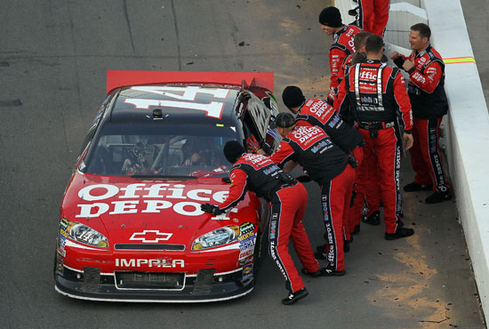 Tony Stewart celebrates with his No. 14 Office Depot Stewart-Haas Racing team after getting his third win in the Chase for the NASCAR Sprint Cup at Martinsville Speedway on Sunday. (Credit: Streeter Lecka/Getty Images)