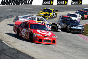 Juan Pablo Montoya runs high as Brian Vickers spins during the NASCAR Sprint Cup Series TUMS Fast Relief 500 at Martinsville Speedway on Sunday.(Credit: John Harrelson/Getty Images for NASCAR)