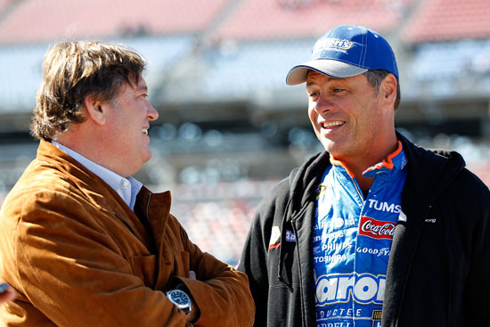 NASCAR Vice President of Competition Robin Pemberton jokes with Michael Waltrip, who qualified 23rd in a tribute car to his brother Darrell's Hall of Fame Induction. (Credit: Geoff Burke/Getty Images for NASCAR)