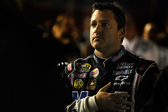 Tony Stewart, driver of the #14 Mobil 1/Office Depot Chevrolet, stands on the grid prior to the NASCAR Sprint Cup Series Bank of America 500 at Charlotte Motor Speedway on October 15, 2011 in Charlotte, North Carolina. (Credit: Jason Smith/Getty Images for NASCAR)