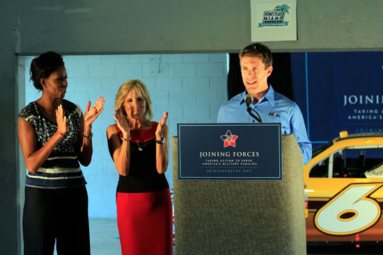 Carl Edwards introduces First Lady Michelle Obama (left) and Dr. Jill Biden at a Joining Forces pre-race event at Homestead-Miami Speedway on Sunday, Nov. 20. (Credit: By Chris Trotman, Getty Images for NASCAR)