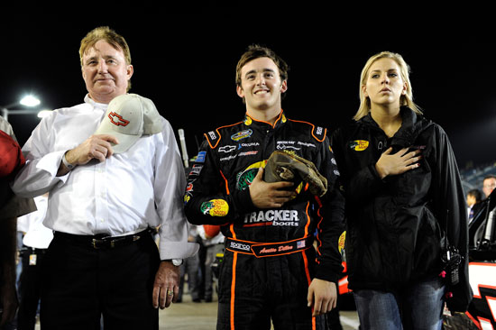 Team owner Richard Childress (left), Austin Dillon (center) and his girlfriend stand on pit road during pre-race ceremonies at Homestead-Miami Speedway in the NASCAR Camping World Truck Series finale. (Credit: By John Harrelson, Getty Images for NASCAR)