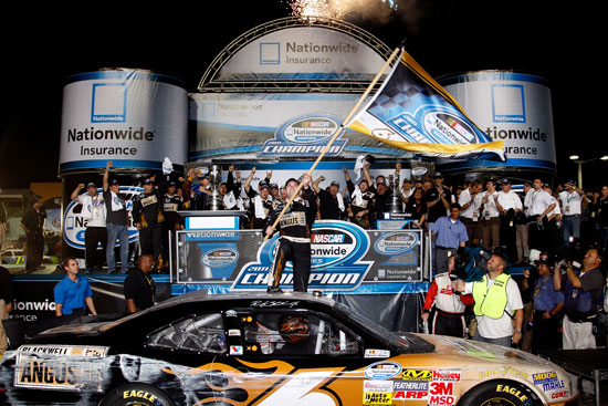 Ricky Stenhouse Jr. hoists a championship flag after clinching the NASCAR Nationwide Series crown at the Ford 300 season finale at Homestead-Miami Speedway on Saturday, Nov. 19. (Credit: By Chris Graythen, Getty Images)