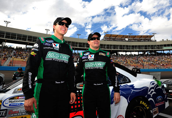(Left to right) Roush Fenway Racing teammates Trevor Bayne and Ricky Stenhouse Jr. get together on the grid before the NASCAR Nationwide Series Wypall 200 on Saturday at Phoenix International Raceway in Avondale, Ariz. (Credit: Rainier Ehrhardt/Getty Images for NASCAR)