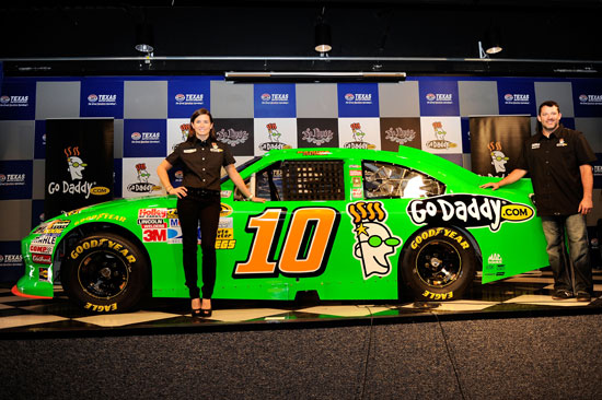 Danica Patrick unveils her No. 10 GoDaddy.com Chevrolet for the 2012 season with team owner Tony Stewart following practice for the NASCAR Sprint Cup AAA Texas 500 at Texas Motor Speedway on Nov. 4 in Fort Worth, Texas. (Credit: John Harrelson/Getty Images for NASCAR)