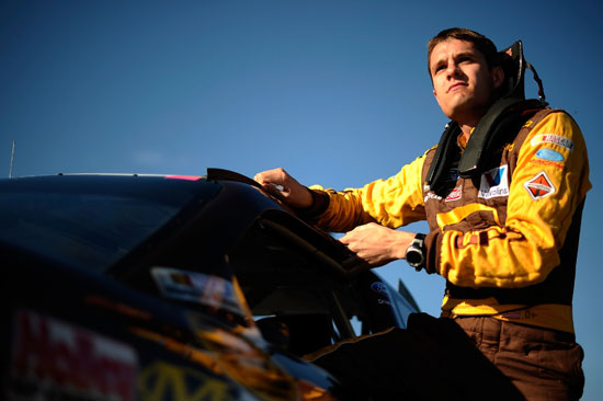 David Ragan, driver of the #6 UPS My Choice Ford, climbs from his car after qualifying for the NASCAR Sprint Cup Series AAA Texas 500 at Texas Motor Speedway on Nov. 4, 2011, in Fort Worth, Texas. (Credit: Jared C. Tilton/Getty Images for NASCAR)