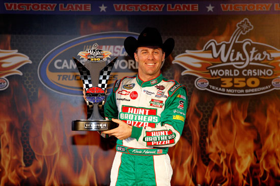 Kevin Harvick, driver of the #2 Hunt Brothers Pizza Chevrolet, poses in Victory Lane after winning the NASCAR Camping World Truck Series WinStar World Casino 350k at Texas Motor Speedway on Nov. 4, 2011, in Fort Worth, Texas. (Credit: Chris Graythen/Getty Images)