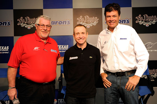 Ken Butler, president of Aaron Sales and Lease poses with driver Mark Martin and team owner Michael Waltrip after announcing Martin's move to the No. 00 Aaron's Toyota prior to practice for the NASCAR Sprint Cup AAA Texas 500 at Texas Motor Speedway on Nov. 4 in Fort Worth, Texas. (Credit: John Harrelson/Getty Images for NASCAR)
