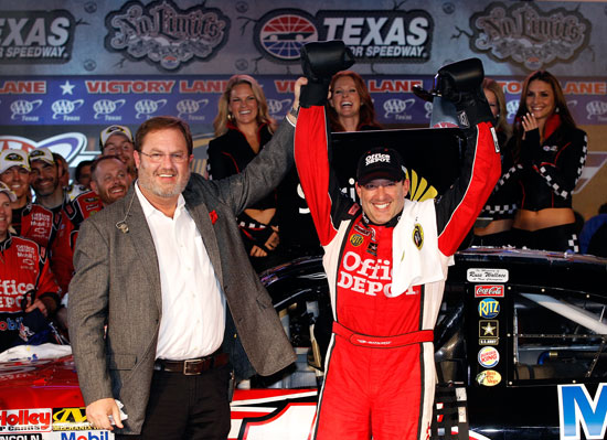 Texas Motor Speedway president Eddie Gossage (left) poses with Tony Stewart, driver of the #14 Office Depot/Mobil 1 Chevrolet, in Victory Lane after Stewart won the NASCAR Sprint Cup Series AAA Texas 500 at Texas Motor Speedway on Nov. 6, 2011, in Fort Worth, Texas. (Credit: Chris Graythen/Getty Images)
