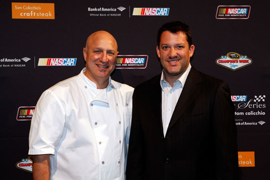 NASCAR Sprint Cup Series champion Tony Stewart, right, and Chef Tom Colicchio attend the NASCAR Evening Series during the NASCAR Sprint Cup Series Champion's Week at Tom Colicchio's Craftsteak inside the MGM Grand Hotel/Casino on Nov. 30, 2011, in Las Vegas, Nev. (Credit: Chris Graythen/Getty Images for NASCAR)