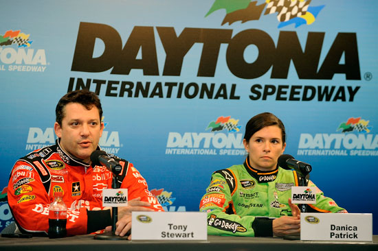Credit: Jared C. Tilton/Getty Images for NASCAR Tony Stewart (left), driver of the No. 14 Office Depot/Mobil 1 Chevrolet, and Danica Patrick, driver of the No. 10 GoDaddy.com Chevrolet, speak to the media during Daytona Preseason Thunder at Daytona International Speedway on Jan. 12 in Daytona Beach, Fla.