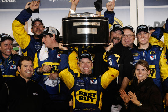 Matt Kenseth raises the Harley J. Earl Trophy for the second time after winning the Daytona 500 at Daytona International Speedway.  (Credit: Jared C. Tilton/Getty Images for NASCAR)