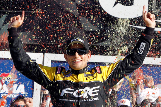 James Buescher celebrates winning the DRIVE4COPD 300 at Daytona International Speedway, his first career NASCAR Nationwide Series win. (Credit: Todd Warshaw/Getty Images for NASCAR)