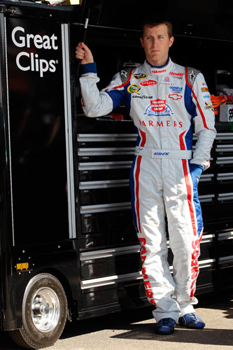 Kasey Kahne stands in his garage during a break in NASCAR Nationwide Series practice on Friday at Phoenix International Raceway in Avondale, Ariz. Kahne turned the fastest lap in final NASCAR Nationwide Series practice, turning a circuit in 26.645 seconds at 135.110 mph. (Credit: Tyler Barrick/Getty Images for NASCAR)