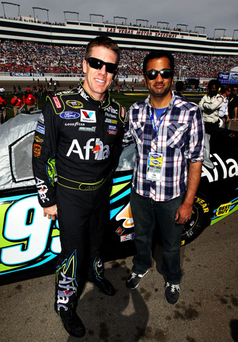Defending NASCAR Sprint Cup Series Kobalt Tools 400 race winner Carl Edwards welcomes actor Kal Penn, from the 'Harold and Kumar' movies, on Sunday to Las Vegas Motor Speedway in Las Vegas, Nev. (Credit: Jeff Bottari/Getty Images for NASCAR)