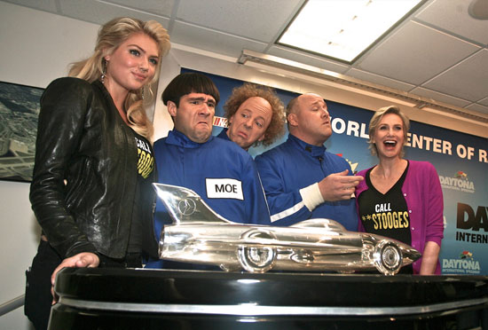 Kate Upton and Jane Lynch pose with The Three Stooges and the Harley J. Earl trophy prior to the 54th running of the Daytona 500. (Credit: ISC Images and Archives)