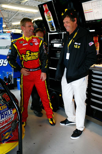 (L-R) Clint Bowyer, driver of the No. 15 5-hour Energy Toyota, talks with team owner Michael Waltrip talk in the garage during practice for the NASCAR Sprint Cup Series STP 400 at Kansas Speedway on Friday in Kansas City, Kan. (Credit: Tyler Barrick/Getty Images)