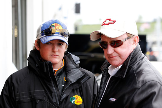(L-R) Ty Dillon, driver of the No. 3 Bass Pro Shops/Allstate Chevrolet and owner Richard Childress talk in the garage during practice for the NASACAR Camping World Truck Series SFP 250 at Kansas Speedway on Friday in Kansas City, Kansas. (Credit: Geoff Burke/Getty Images for NASCAR)