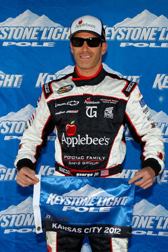 Tim George Jr. celebrates his first career NASCAR Camping World Truck Series Keystone Light Pole Award for the SFP 250 on Saturday at Kansas Speedway in Kansas City, Kan. (Credit: Tyler Barrick/Getty Images)